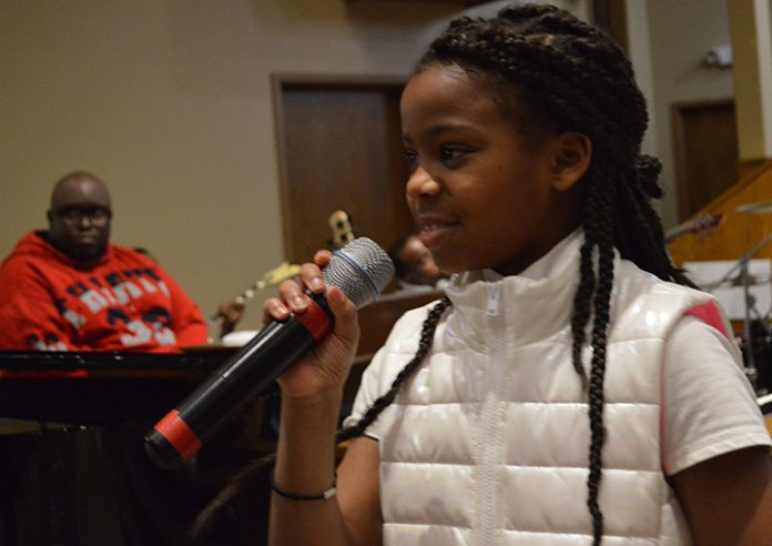Alana Bracey, a fourth-grader at Southwest Community Campus School, brought the audience to its feet with her powerful voice