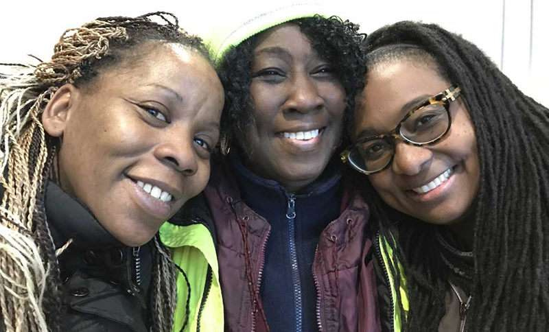 Kattie Eason flanked by, left, parent Aquenda Doyle, and right, special education teacher Sheena Brown (photo by Tom Rademacher)