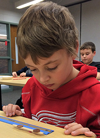 Nicholas Burkel, of Forest HIlls, works on the classroom activity