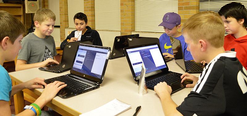 Robotics students work on coding
