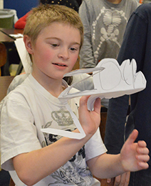 Third-grader Zachary VanderMeer holds up his name monster cut-out