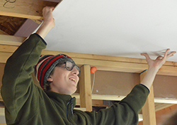 Senior Corbin Butterly hoists up the drywall