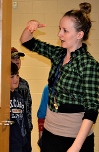 """Teacher Linda Tata lines students up outside classroom door and lets them in single file so they see the room as a """"learning space"""""""