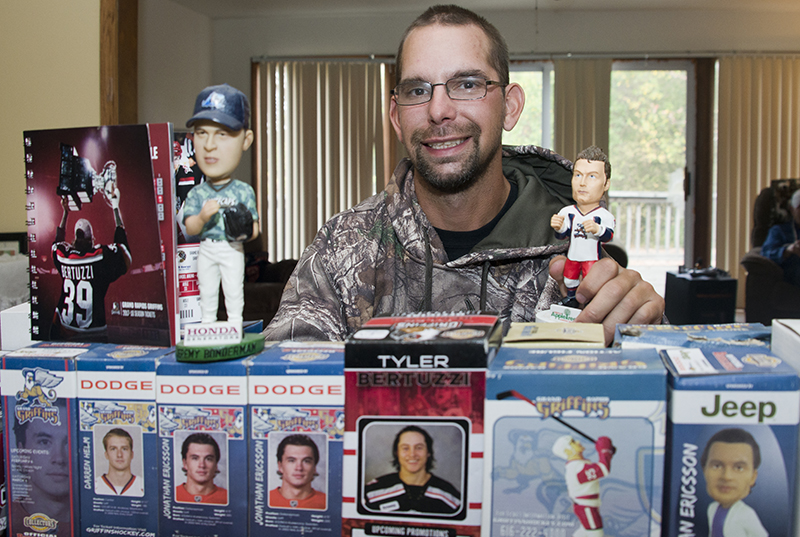 Alanowski with his bobblehead sports collection; his favorite is hockey