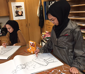 From left, East Kentwood High School students Nisa Brooks and Adilene Garcia are earning credit in AP art