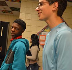Ke'Waun Blackmon and Jaden DeLosh walk to their lockers between class