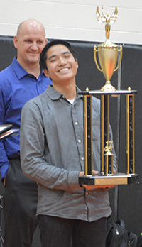 Braden VanDyk learned he had won the InvestWrite competition during a school assembly