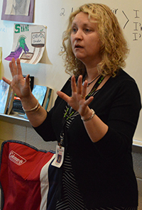 """Cedar Springs seventh-grade teacher Amy Blauw tells her students what to listen for as they read along to """"The Gardener"""""""