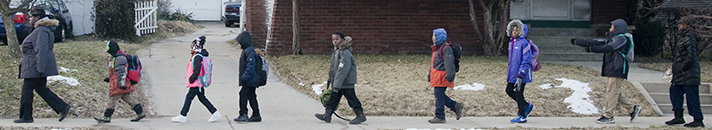 Parent leader Cynthia Jackson, left, walks with first-grader Jacoby Scott; Keona Jackson; third-graders Isaiah Miller, Amir Pratt, Tyonna Jackson and Maurice Merritt; and second-grader Kamarrie Key, with parent leader Ashley Pinder at the back of the line