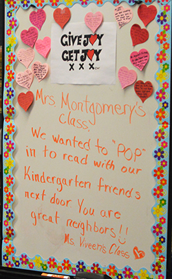 The Joy Board goes from classroom to classroom, doing good deeds along the way