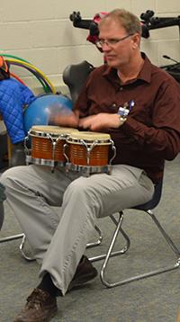 Sparta Middle School CI teacher Doug Peterman demonstrates a cool rhythm on the bongos