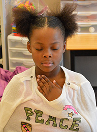 Kamari'a Rogers-Brown practices mindfulness -- being aware of sounds and feelings