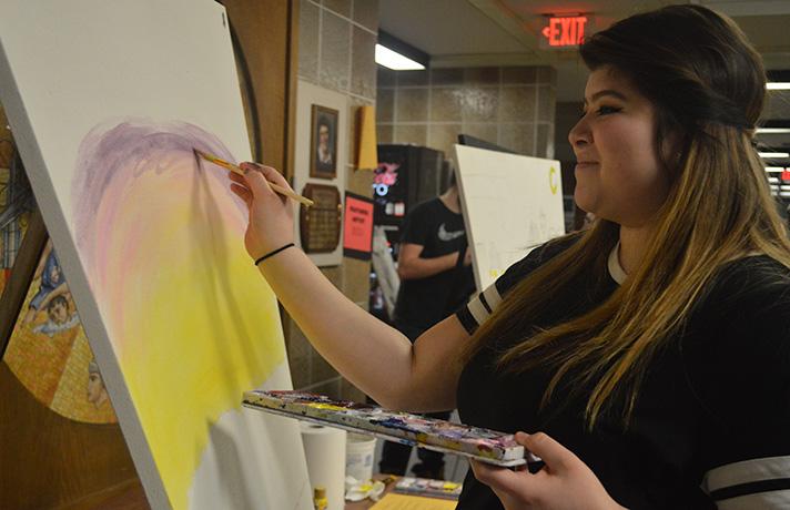Godwin Heights High School Senior Yaneli Fragosa works on an acrylic painting