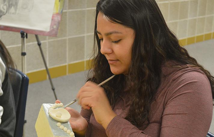 Senior Valerie Zamora paints a clay jewelry box she created