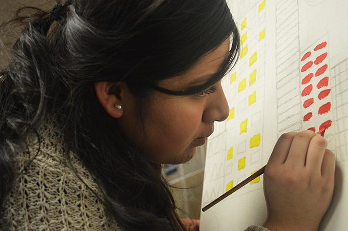 Senior April Martinez gets up close to her work