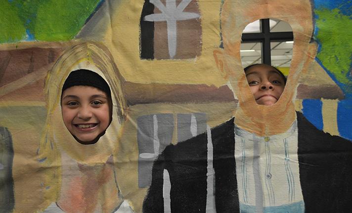 North Godwin Elementary School second-grader Mily Duran and Wyoming Intermediate School fifth-grader Leyla Cruz become part of the art