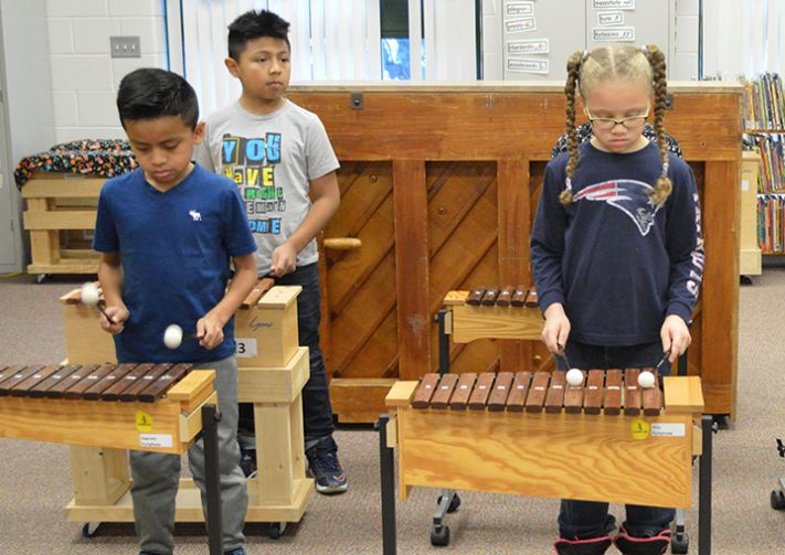Students take turns on the xylophones