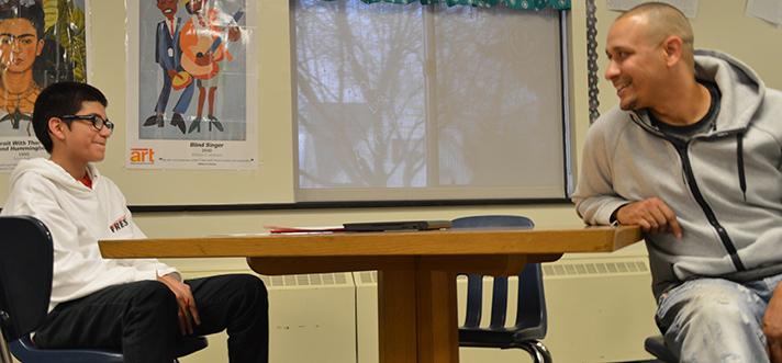 Lambers checks with Efren Ramirez about his biology homework