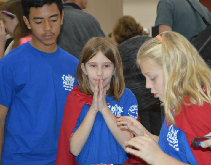 Kung Foo Panda team members Olivia Prindle, left, and Hannah Kempf from Grandville Grand View Elementary are tense when their robot starts its trek, excited when it accomplishes its missions and overjoyed when it completes them all