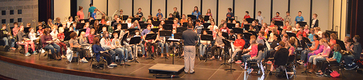 The Cedar Springs sixth-grade band gathers at the high school auditorium to rehearse for the holiday concert