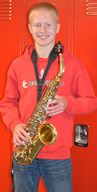 Kent City senior Zach Carlson shows off the saxophone he's played since sixth grade
