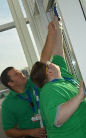 Nathaniel Plude of Comstock Park High gets help with hard-to-reach spots from CORE Director Michael Spagnuolo