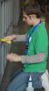 Matthew Meyer of Lowell wipes down personal storage areas