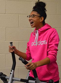 Cydney Hansma uses the elliptical in gym class