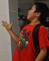 Student David Garcis-Alonzo make a toy fly