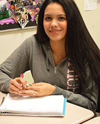 Ninth grader Cintia Ruiz Perez, who moved from Cuba a year ago, smiles in teacher Edith Trumbell's class