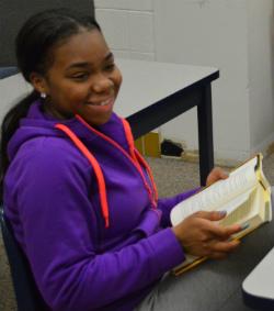 Senior Zy Scott plops down with a book