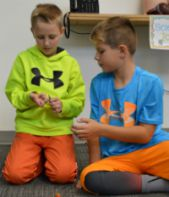 Aiden Vermerlen and Kevin Simo get ready to chuck pumpkins