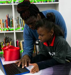 Tashaya Dannah checks out a new laptop with her mother, Latasha Gates