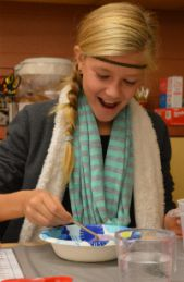 Addi VanOost smiles as the slime takes shape