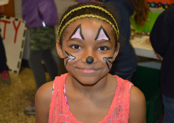 Third-grader Breanna Strickland shows off her cat ears and whiskers