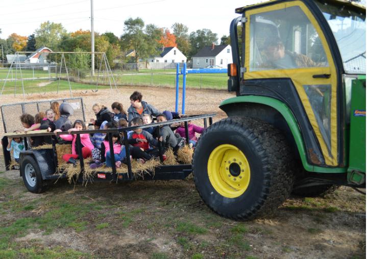 """Farmer Greg"" Height, maintenance director, annually provides the hayrides via tractor"