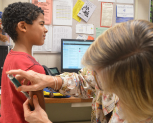 A diabetic Ridgeview student receives a shot of insulin