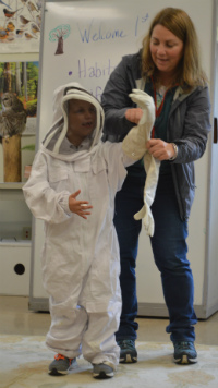 Caden Gahan tries out a beekeeping outfit