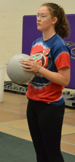 Alissa Richardson, a Forest Hills Central High School sophomore, gets ready to add a ball to the competition floor