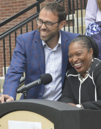 Superintendent Teresa Weatherall Neal and school board President Tony Baker enjoy a moment at the press conference