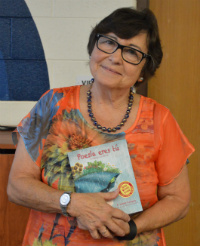 """F. Isabel Campoy holds a copy of her new book, """"Maybe Something Beautiful"""" at Westwood Middle School"""