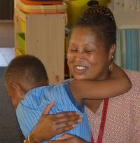 Kindergartner Ricky Brooks gives Christie Alexander an impromptu embrace