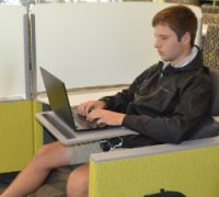 """Junior Nate Spitzley in what learning commons coordinator Cathy Szivan calls a """"Jetson seat"""""""