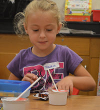 A student at Wyoming's West Elementary has some breakfast during orientation