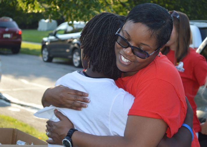 Endeavor Elementary School fourth-grade teacher Sheree Bos hugs Pinewood Middle School seventh-grader Sonia Franks