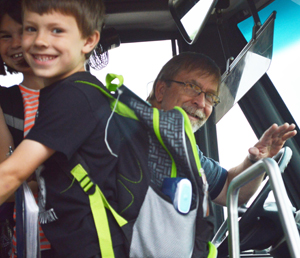 Students boards the bus with driver Dave Smith at the wheel