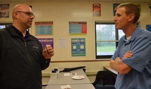 Teachers Jeff Bush and Gerry Verhey chat