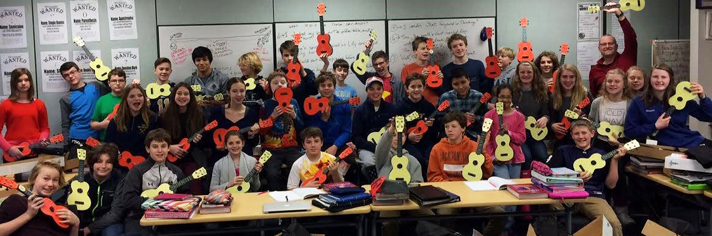 East Grand Rapids Middle School students hold the 40 ukuleles the class won through an online contest