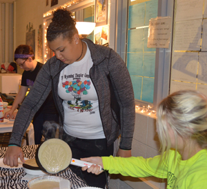Freshman Maya Miller prepares crepes during the French feast