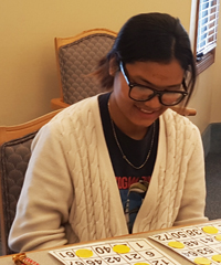 Kelloggsville High School senior Dim Ciin eyes her Bingo board